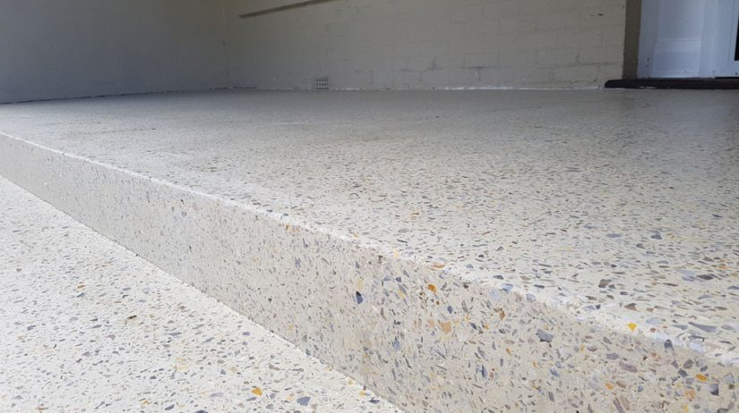 A light sandy aggregate concrete patio