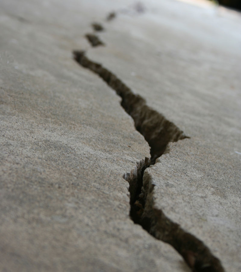 An image showing really badly cracked concrete