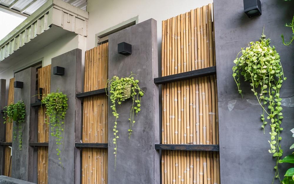 A bamboo and concrete garden wall
